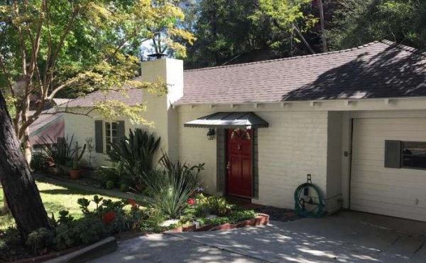 Located in the Desirable San Rafael Hills, this Charming Home is a Great Retreat.